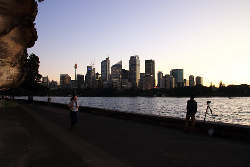 sydneyharbour nsw australia sydney sunset jogger photographer towers buildings skyscrapers water rocks sky