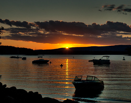 sunset sky orange reflection water clouds boats horizon sacandaga
