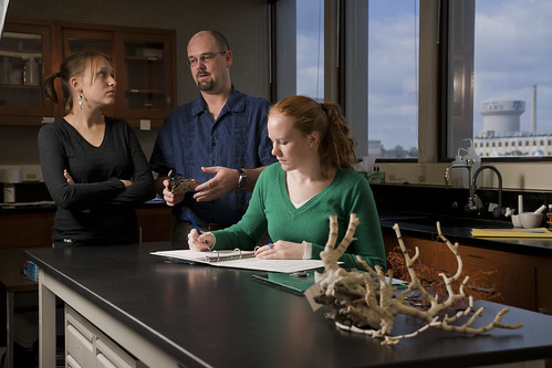 Students with Professor Examining Samples