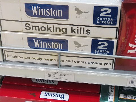 Cartons of cigarettes for sale in duty free shop -- cough, cough | by kthypryn