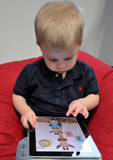 Child with Apple iPad | by IntelFreePress