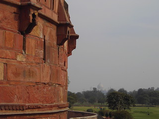 Agra. The Agra Fort walls.  Near the entrance to Agra Fort. The Taj Mahal is in the background.