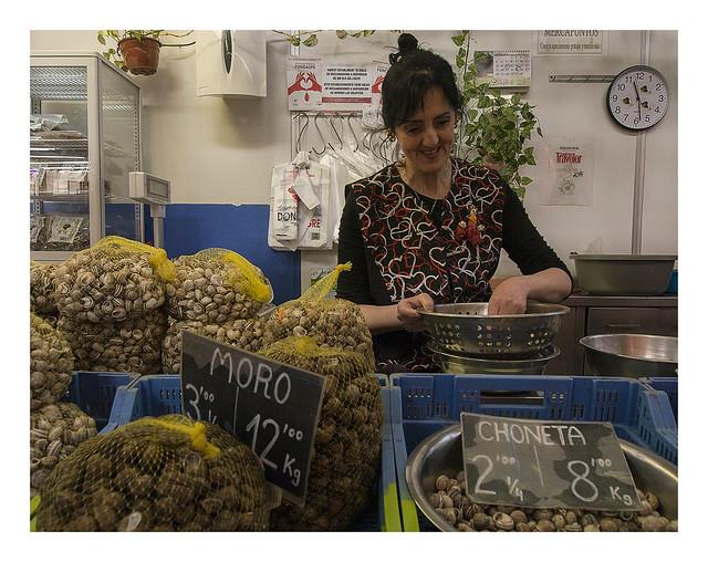 Vendor of snails  at the Mercat Central of València.