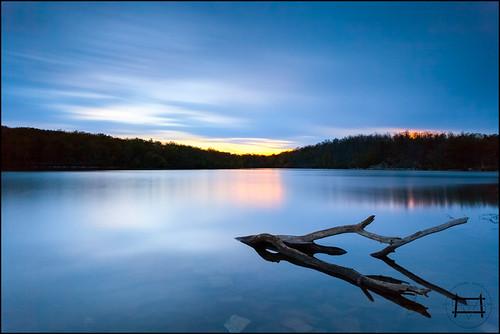 longexposure sunset lake water rock canon landscape eos newjersey log branch nj driftwood deadtree filter lee nd 1740mm delawarewatergap sunfishpond worthingtonstateforest cokinzpro 5dmarkii bigstopper