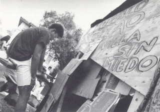 Paul Ali '91 with a shantytown constructed by students in March 1989 for a weeklong demonstration to protest U.S. military aid to El Salvador.