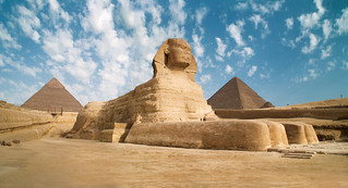 Egypt Giza Sphinx with pyramids in the background | by Traveloscopy