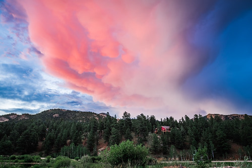 mammatuscloud peaks pine cloudy mountains pines mammatus clouds rockymountains landscape summer storm lowerlakeranch blue red forest house colorado sky green ranch sunset road pink unitedstates us