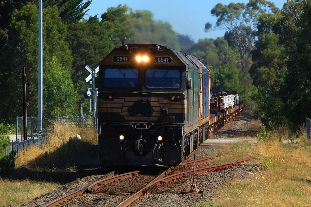 G541 and BL29 charge their way though Baxter on an empty Long Island steel train by bukk05