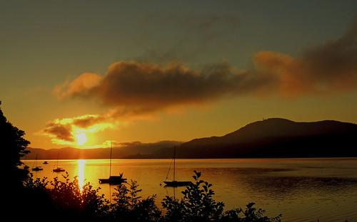 sunset lake sunrise boot see österreich kärnten carinthia sonne sonnenaufgang velden carinzia wörthersee pörtschach morgenröte mariawörth pyramidenkogel flickraward sonnenaufgangwörthersee