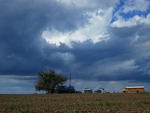 school sky storm bus tree field clouds farm crop