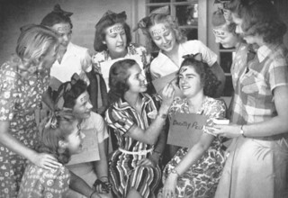 """First-year women paint """"frosh"""" on their foreheads. Photo from 1939 Metate."""