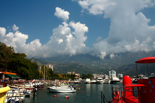 budva montenegro city bluesky clouds people sun sunny sunshine goodweather sunnyday light sea adriaticsea water nature trees boats seafront mountains reflection house building crane vacation travel journey trip travelling white blue black brown green autumn fall september canon canoneos1000d 14092016 30092016 brilliant dragonsdanger