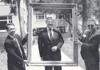 A good-natured pose is struck by President Emeritus David Alexander during the dedication of Pomona's Alexander Hall for Administration on April 25, 1992. President Peter Stanley and Vice President Ted Gibbens hold the frame.