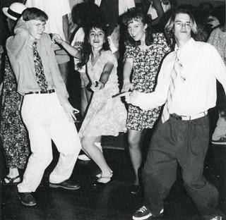 Chris Harry '97, Celina Torres '96, Karen Crowley '97 and Chris Martin '98 strike a pose during a dance in 1994.