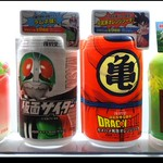 "CARBONATED ANIME DRINKS in an OKINAWA VENDING MACHINE The latest ""Soda Craze"" from DyDo Drinks --- (1) MASKED RIDER CIDER on the middle left, and (2) DRAGON BALL ORANGE SODA on the middle right.     ""Cider"" is a generic word used in the soft drink industry for what is basically any lemon-lime flavor.  Actually, the Drink name is ""MASKED CIDER"",  playing a rhyme off the main character's name.  The Japanese KAMEN RIDER (Masked Rider) live-action television series, animated cartoons, manga, and movies have long been popular with the kids, and you can collect NINE DIFFERENT CAN DESIGNS, all with your favorite characters from the series.   en.wikipedia.org/wiki/Kamen_Rider  The animated DRAGON BALL manga series, animated cartoons, films, and all kinds of spin-off games, toys, and other merchandise also remain popular here in Japan.   en.wikipedia.org/wiki/Dragon_Ball  You can collect NINE DIFFERENT CAN DESIGNS for each of the two subjects, all with your favorite characters from each TV series.  There is only one button for either choice on every vending machine that has them, and what pops out will be one of the nine-designs --- which are all randomly loaded into the feed-chutes inside the machine.  I wonder if the local association of Children's Dental Practitioners fully approves of this ?  NOTE :  The above photo was shot at night, and can be seen in context HERE (see the in-photo note) :  www.flickr.com/photos/24443965@N08/8227031334/  *  *  *  RANDOM SOBA :  www.flickriver.com/photos/24443965@N08/random/"
