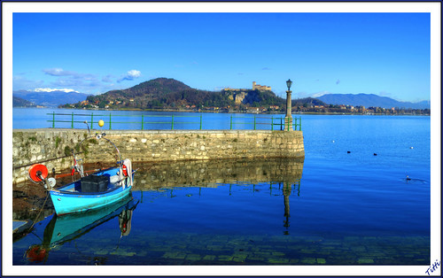 Arona the pier, against the backdrop Castle Angera