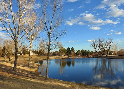 briargate reflectionpond briargatecoloradosprings janeelizabethlazarz walkingcolorado nikon p900 nikonp900 coloradosprings colorado janelazarz breathtakingcolorado sunset goldensunset water blue pond trees winter landscape clouds reflectioninwater reflection sky