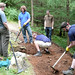 Sat, 07/28/2007 - 12:02 - On the 28th of July 2007 the Trailfairies descended on the Lombard Street section of Glentress's red route in order to repair a switchback corner that was showing signs of damage.  Here a number of trailfairies work on installing a drain to run under the corner's exit.