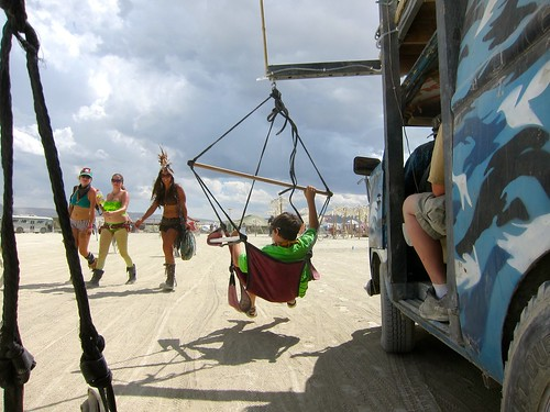 Just hanging out and cruising the playa in a VW hammock bus.  The guy driving was this kid's dad, and the kid was about 12, and had been on the playa 5 times. He *owned* it. | by jetsetwhitetrash