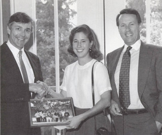 Emily Moseley '95 and President Peter Stanley presenta  photogrraph of participating students to trustee Ranney E. Draper '60 in appreciation of his funding the community outreach program Colleges Helping in Realizing Potential (CHIRP)