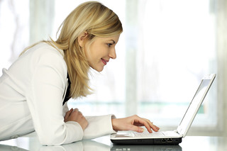 Woman with laptop. | by TraderGroup Signal