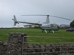 R44 Helicopter EI-YBZ in someone's front garden