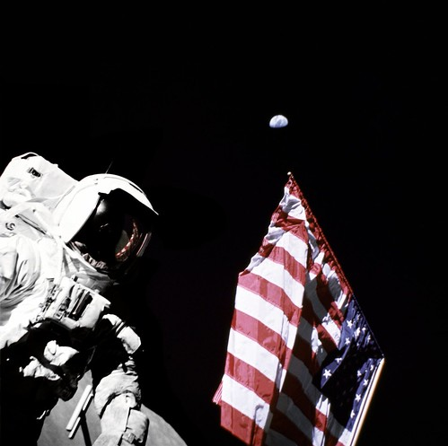 Schmitt with Flag and Earth Above | by NASA Goddard Photo and Video