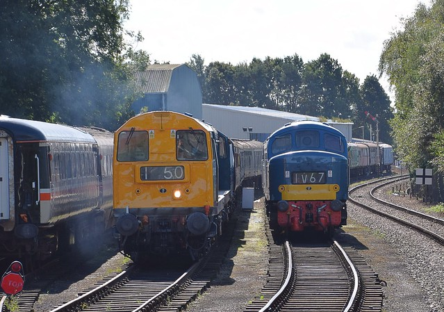 Class 20s 20189 & 20205 ready to leave the holding sidings and attach to the train arriving in the Station at Dereham, as D182 (46045) is shut down, between turns. Autumn Diesel Gala, Mid Norfolk Railway 08 09 2016