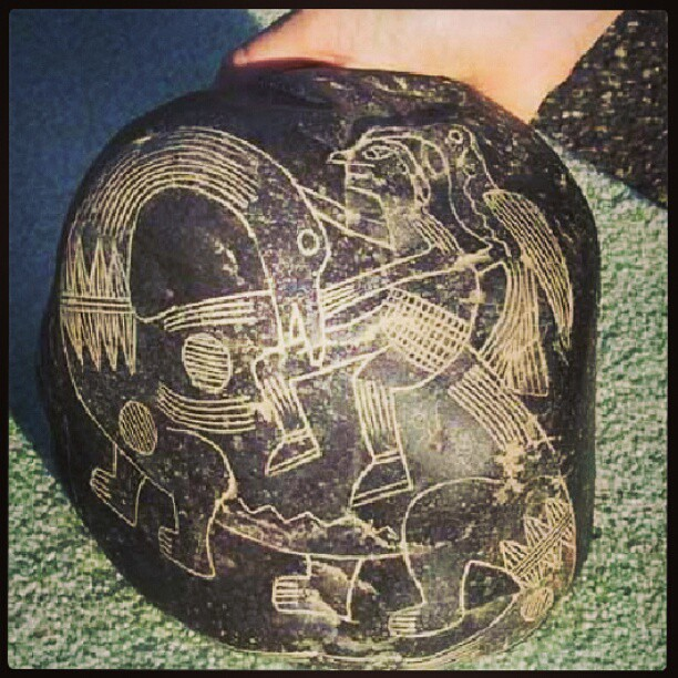 Ancient Ica stone that depicts a human riding a dinosaur.