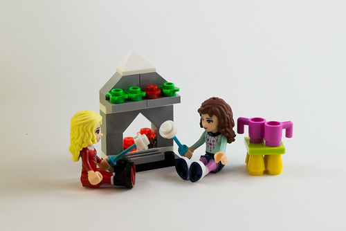 The girls toast marshmallows by the fire   by The LEGO woman