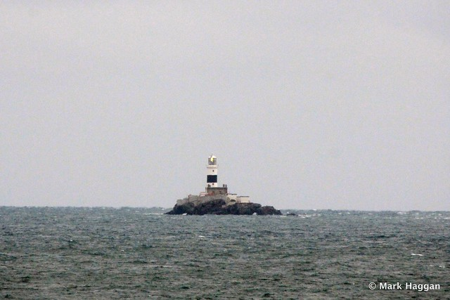 The Maidens Lighthouse, near Larne, in the Irish Sea