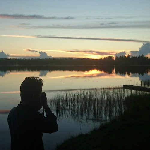 Photographer and the sunset, Finland   by anywhereism