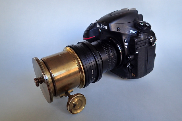 Unnamed, brass-bound 5-inch projection lens in Cindo (Paris)  dual control brass focussing mount