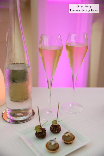 Amuse bouches of foie gras rolled in cocoa nibs and an anchovy tart and Champagne to start