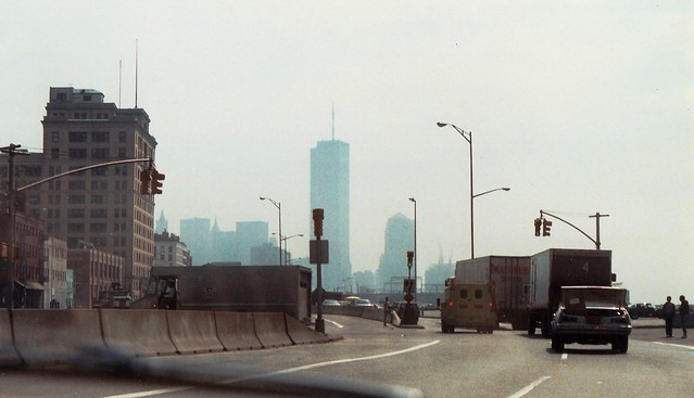 West Street in the 1980s. The city had already torn down a good portion of the abandoned West Side Highway and turned West Street back into a street-level road. The World Trade Center hovers in the distance. Shot from my '82 Honda Civic. New York. 1984