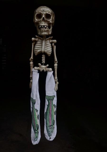 Skeleton Wearing Full Leg Fish Socks