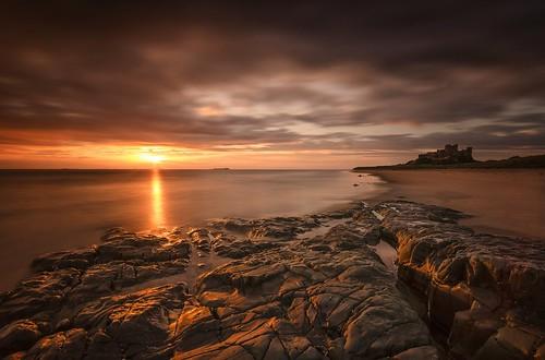northumberland bamburghcastle bamburgh northeast coastal coast beach moody longexposure verylongexposure bigstopper 10stops reflections cloudmovement gold rocks nikond7000 sigma1020mmf4