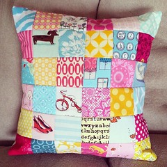Last nights midnight project--quick patchwork pillow. After i finished it, i decided it really needs pink pom-poms around the outside, so maybe have to rip some seams and do that after the move