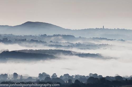 uk morning trees england mist rural sunrise landscape countryside shropshire hill peaceful clocktower hills telephoto serene clee abberley cleehill