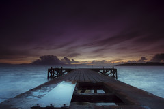 Wrecked pier after sunset