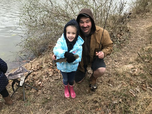 Photo of father and daughter fishing at a rodeo