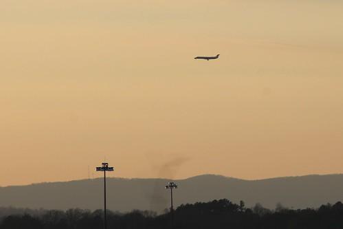 sunset sky chattanooga plane airplane evening flying landing