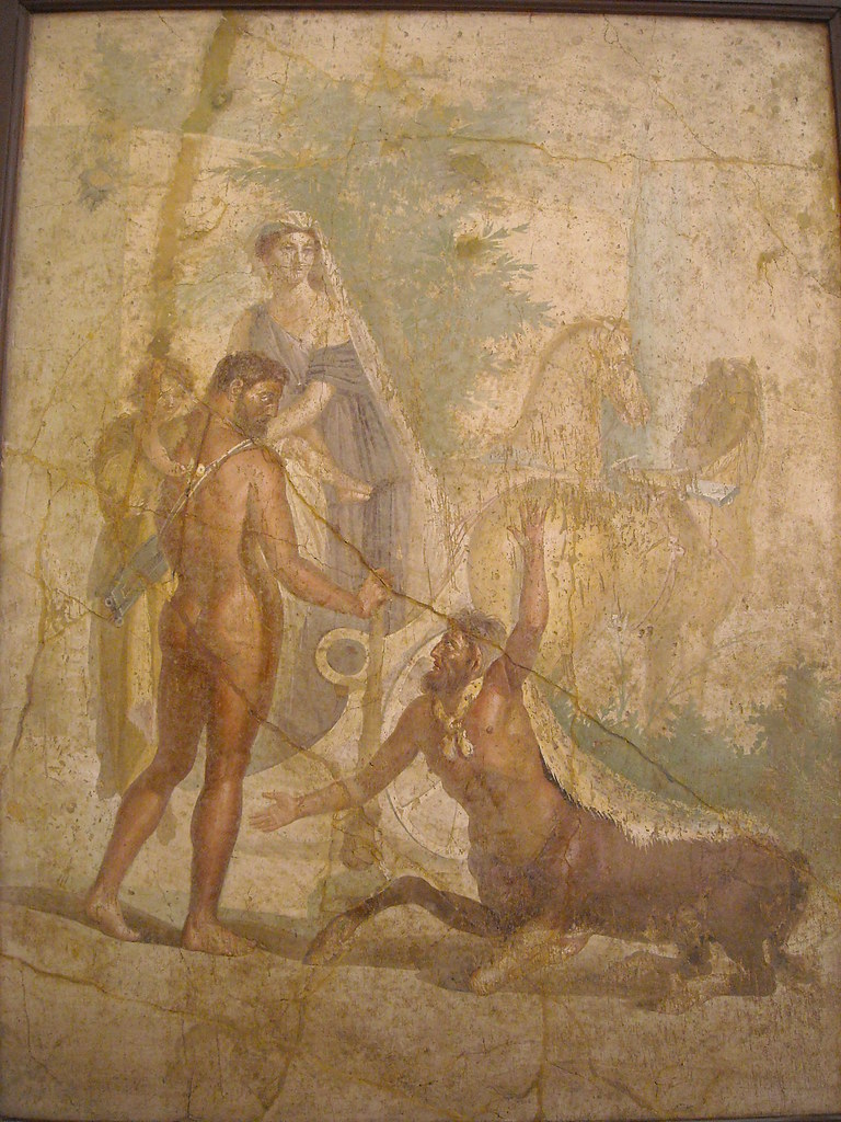 Hercules, who is carrying Hyllus in one arm, looks towards