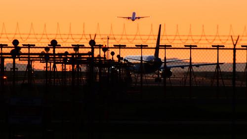 vancouver yvr airport departure runway takeoff international sunset richmond britishcolumbia bc landscape silhouette dusk aeroplane jet airplanes fence nikon d7000 zoom 70300mmzoom flights
