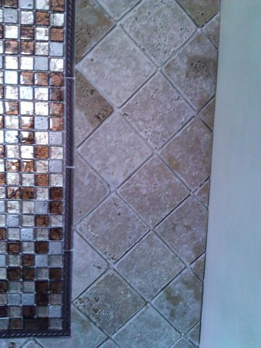 Travertine and glass mosaic accents