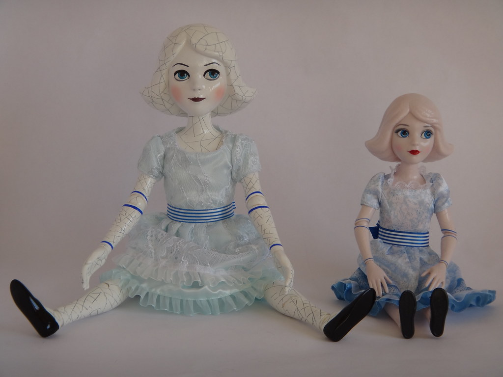 Comparing China Girl Dolls - Disney Store vs Tollytots - Oz The Great and Powerfull - Sitting Down - Full Front View