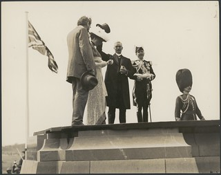 Andrew Fisher, Lord and Lady Denman and King O'Malley acknowledge the crowd from the foundation stone at the naming of Canberra ceremony, 12 March 1913.