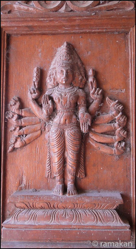 Wood carvings on a temple door rama chandran flickr