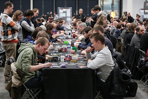 UTRECHT, THE NETHERLANDS - MARCH 16, 2013: People play card games on tournament desks at Magic the Gathering: Grand Prix Utrecht on 16th March 2013.