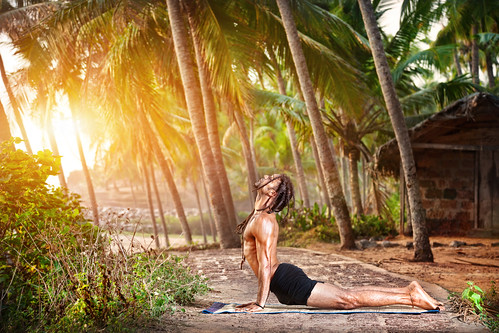 Urdhva Mukha Svanasana (upward facing dog) pose by HAWAH on the beach near the fishermen hut in Varkala, Kerala, India. | by everlutionary